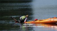 baffinpaddling-demonstrating-cowboy-scramble-up-kayak-with-rudder-wilderness-systems-tsunami-165-sea-kayak.jpg
